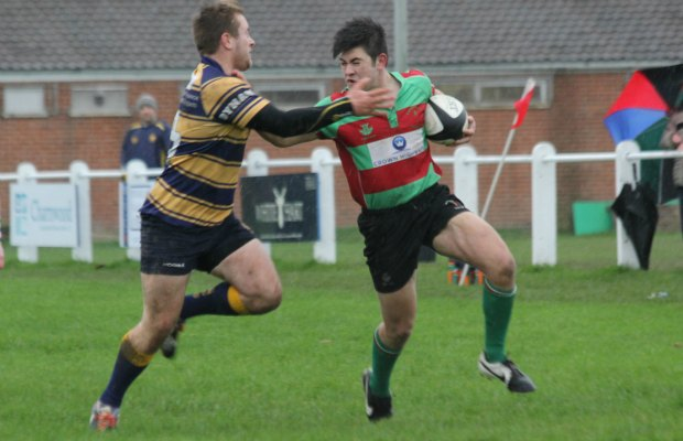 Owen Rookyard tries to hand off a tackler. Pic: Joanne Gough