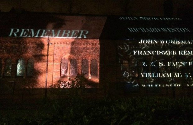 A projection of names is beamed onto the side of St Anne's Church