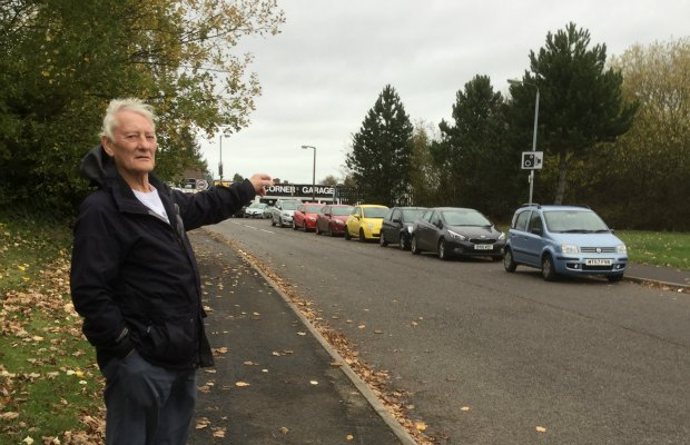 Councillor Eric Drinkwater with some of the parked cars on Ring Road in Burntwood