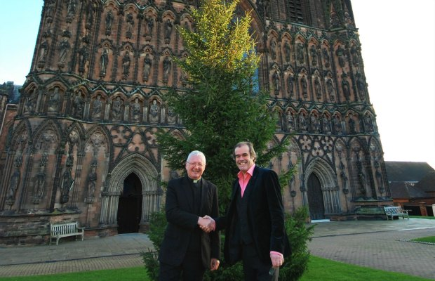 The Very Revd Adrian Dorber, Dean of Lichfield, and Simon Price, CEO of Arthur Price, in front of the Cathedral Christmas tree