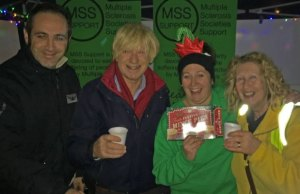 Michael Fabricat enjoying a mulled wine on the Multiple Sclerosis Support stand with local councillors