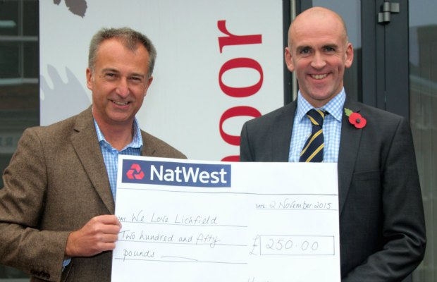 Julian Fisher of We Love Lichfield being presented with a cheque for £250 by Hawksmoor managing director Richard Wain