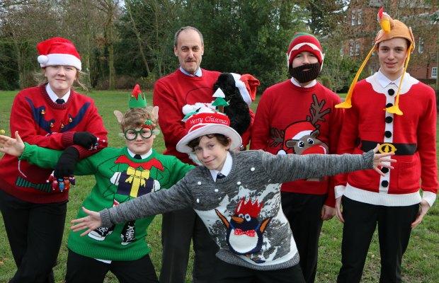 Niamh Padley, Harry Baller, Head Teacher Dr Daryl Brown, school dog Lucy, George Patterson, Joe Cahilland Jacob Morgan in their Christmas jumpers