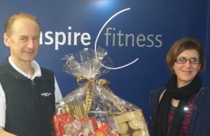 Mark Adams hands over the hamper to Lisa Chmielewska