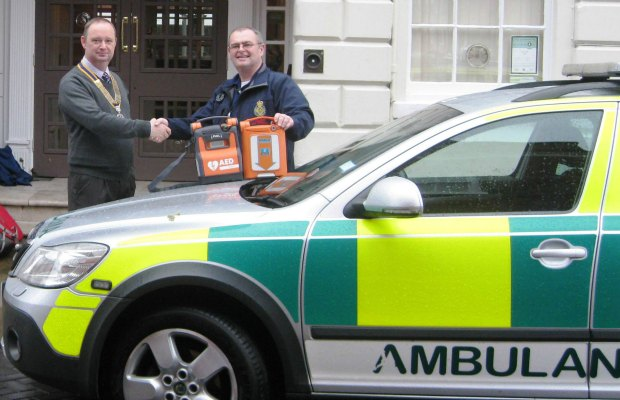 Lichfield St Chad Rotary President David Stainsby presenting the defibrillator to Mark Walker from Lichfiled Trent Valley Community First Responders