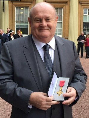 John Woodward with his OBE