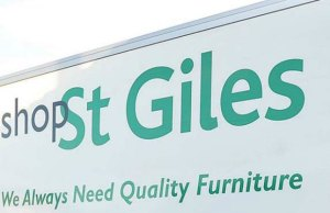 The logo on the side of the St Giles Hospice van