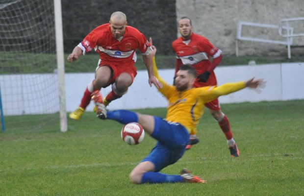 Simon Brown jumps clear of a sliding tackle