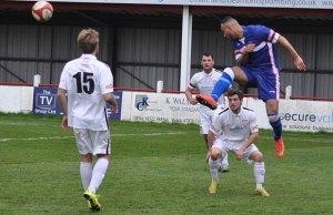 Nick Turton heads the ball. Pic: Pamela Mullins