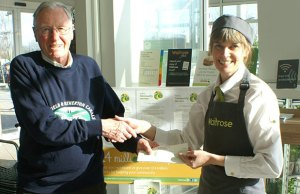 Lichfield and Hatherton Canals Restoration Trust chairman David Dixon receives a cheque from Waitrose's Sarah Fry