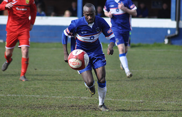 Stan Mugisha drives forward with the ball. Pic: Pamela Mullins