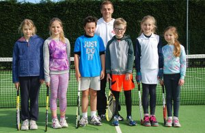 Young players Ella Jeggins, Rachel Bennett, Sebastian Fisher, George Davies, Lucy Keeling and Hannah Sirag with coach Michael Hampson
