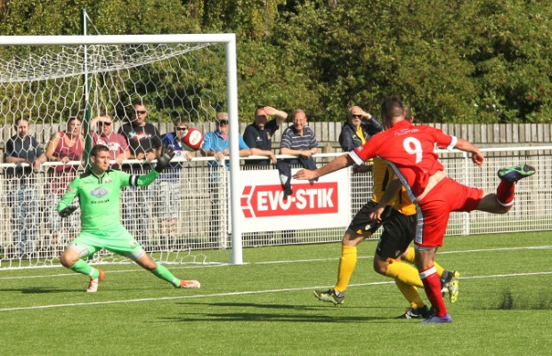 Mitch Piggon fires past Saul Deeney in the Basford goal. Pic: Dave Birt
