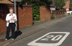 Cllr Sue Woodward with the new 20mph stickers