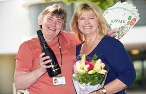 Jo Rushton from St Giles Hospice with winner Alison Barker