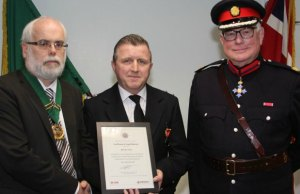 Michael Jones receiving his long service award