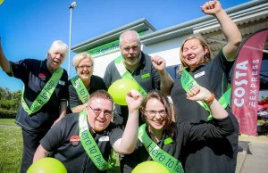 Staff celebrating the refurbishment of the store in Fradley