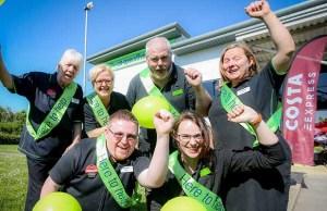 Staff celebrating the refurbishment of the store in Fradley