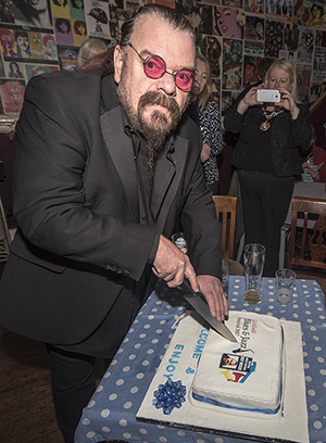Roy Wood cuts the cake at the launch of the Lichfield Blues and Jazz Festival