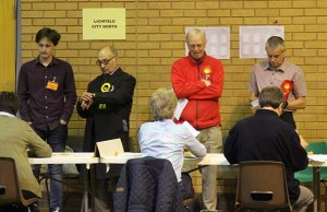 Candidates and agents looking on as the votes are verified