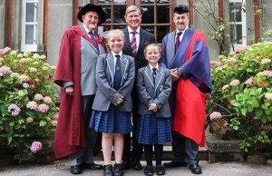 Pupils Katie-Rose Bridgeman and Heidi Fletcher with Dr Neville Brown, Ian Dudson, the Lord Lieutenant of Staffordshire, and Dr Daryl Brown