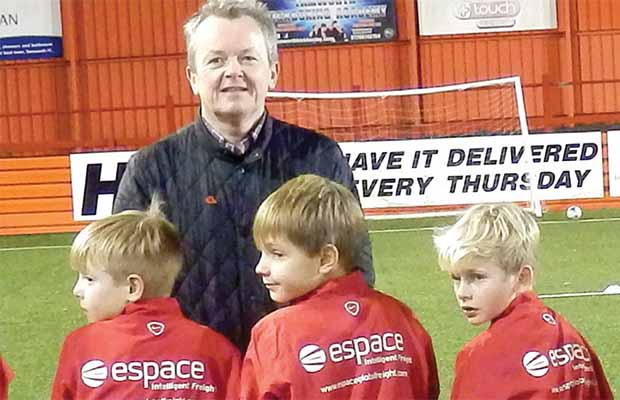 Espace managing director Tony Shally with players from the Whittington Owls U9 team