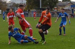Ryan Wynter is denied by the Spalding United keeper. Pic: Louise Yates