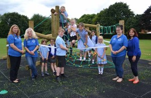 Children enjoying new climbing frame alongside members of the Friends of Hayes Meadow PTA
