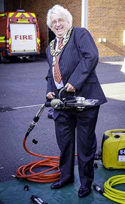 Cllr Mark Warfield tries out some of the equipment at Lichfield Community Fire Station