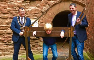 Michael Fabricant in the stocks and with Tamworth Borough Council's mayor Cllr John Chesworth and leader Cllr Daniel Cook