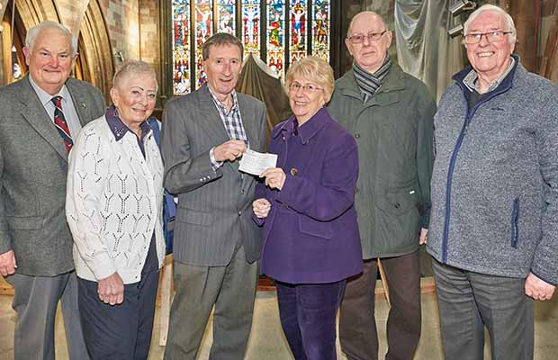 Maureen Woodcock MBE, Chair of Friends of the Garrick, is joined by some of the committee members as she presents the cheque to Nick Sedgwick, Chair of St Mary's Trustees