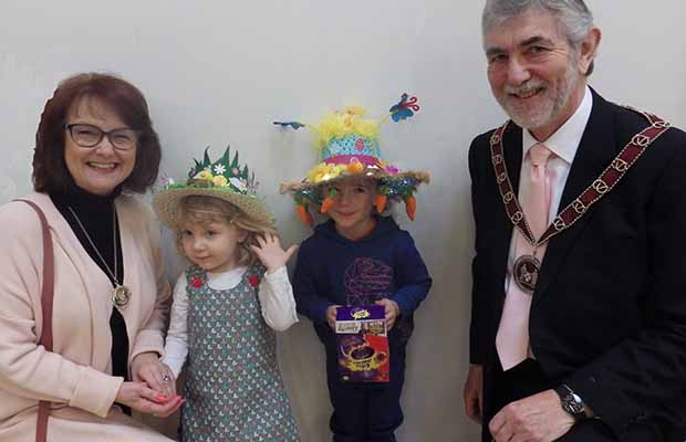 Easter bonnet winners Belle Burton and Thomas West with Cllr David Leytham and his wife Jan