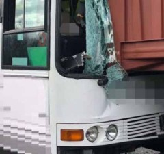 The damaged coach after the crash on the A38