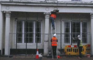 Workmen examining the damage at St Johns House