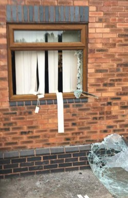 A window smashed by vandals. Pic: Burntwood RUFC