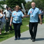 Volunteers carrying the baton through the National Memorial Arboretum
