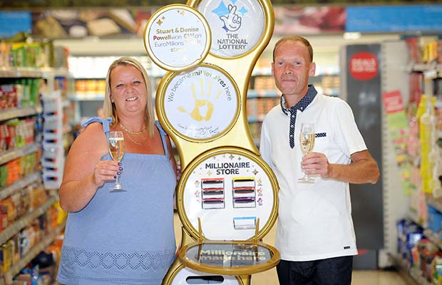 Denise and Stuart Powell with the new golden National Lottery play terminal