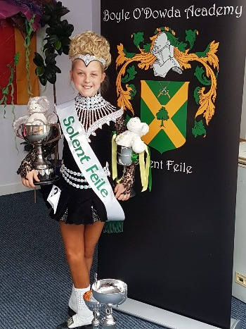 Heidi Hawkes with her trophies from the Solent Feis Irish dancing competition