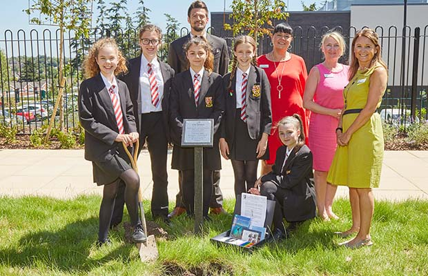 Students and teachers from the Friary School with staff from The Spires care home as the time capsule is buried