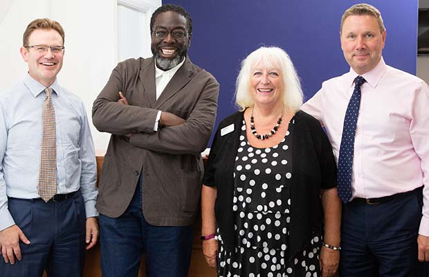 Corporate services executive David Grady, Lord Victor Adebowale, society president Elaine Dean and society secretary Jim Watts