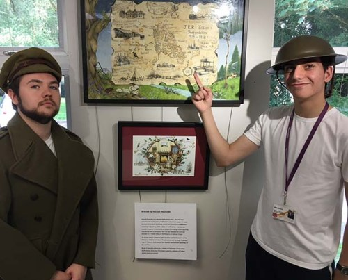 Library staff Matthew Wells and Mikey Robberts with exhibits from the Tolkien exhibition