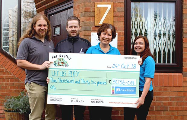 The fundraising cheque is handed over by Cameron Homes