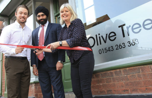 Matt Smith, Dan Pawar from HSBC and Yvonne Smith cutting the ribbon on the reopening of The Olive Tree in Lichfield