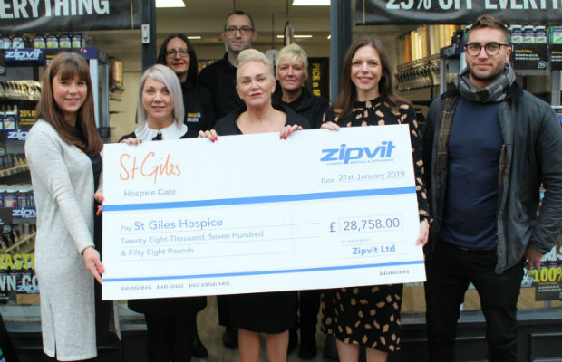 The donation is handed over to St Giles Hospice by Zipvit staff