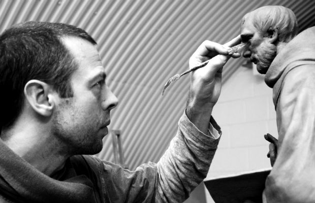 Artist Peter Walker working on a scaled model of the St Chad statue