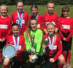 The Fulfen Primary School team with some of their silverware