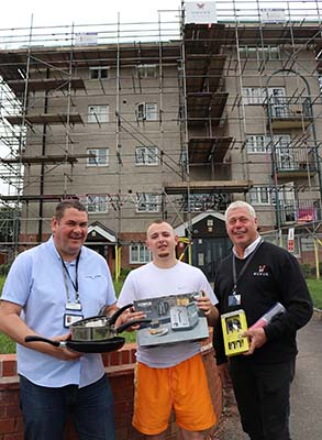 Bromford's Paul Bradley with resident Conner Moore and Novus' Adrian Elsby with some of the donated items outside Edgeworth House
