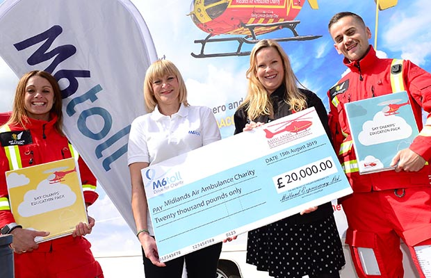 The cheque being handed over to the Midlands Air Ambulance Charity