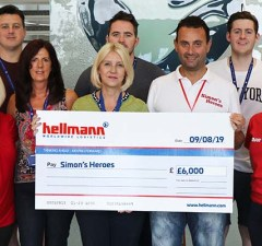 Staff handing over the cheque to Simon's Heroes