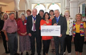 Bob Awty handing over the cheque to Lichfield Memory Cafe